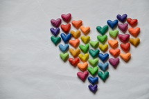 many little colorful hearts shaping a big heart.  heart, hearts, love, brothers, sisters, siblings, disciples, one another, congregation, body, unit, form, build, shape, grow, church, christians, each, believers, many, one body, part, world, nations, together, different, international, body of christ, peoples, appointment, reunion, union, cultures, various, several, diverse, color, colorful, multicolored, symbol,    knead, kneading, clay, dough, John 13