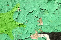 peeling paint on a graffiti covered wall