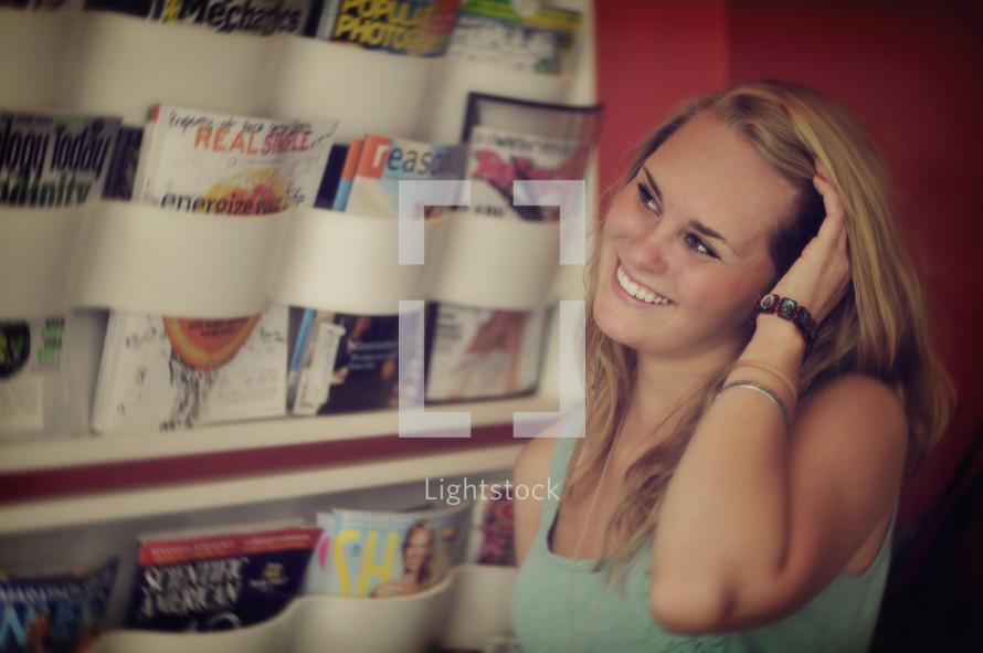 woman at a magazine rack