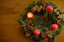 One candle is burning at the Advent wreath for the first advent sunday