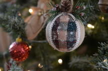 burlap and plaid ornament on a Christmas tree