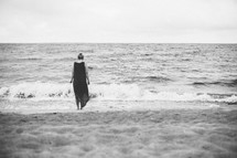 a woman standing on a beach