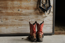 cowboy boots on a stable floor