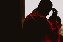 Buddhist monk in prayer