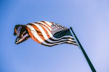 An American flag on a flag pole