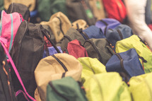 Many colorful backpacks.