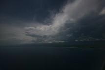 Dark beach storm clouds and rain