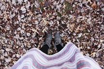 girl standing in fall leaves