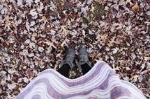 girl standing in fall leaves
