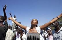 A woman with arms raised in worship