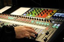 hand on a soundboard