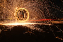 Sparks of circling spinning light