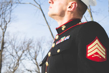 marine in dress blues looking up