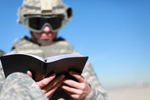 soldier reading a Bible