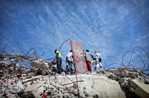 Men clearing disaster debris