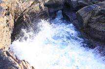 Waves crashing on cliff
