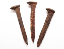 three railroad spikes