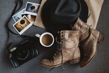 camera, boots, coffee, Polaroids, purse, leather, hat, paper bag, photographer, collection