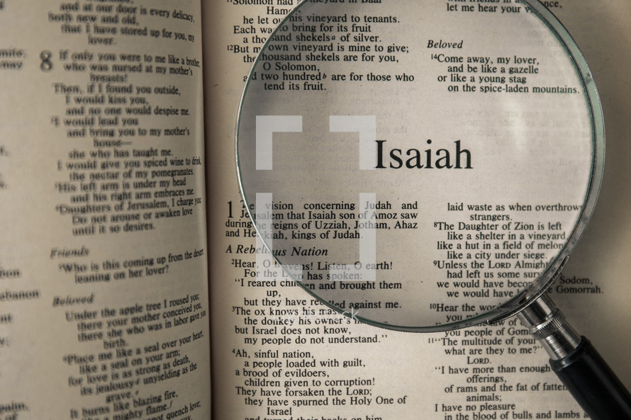 magnifying glass over Bible - Isaiah