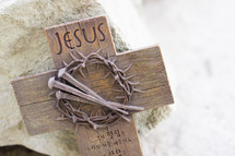 word Jesus engraved in a cross