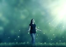 woman enjoying rays of sunlight