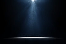 spotlight and dust on an empty stage