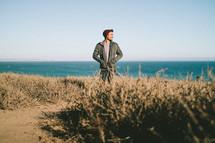 a man standing on a beach shore