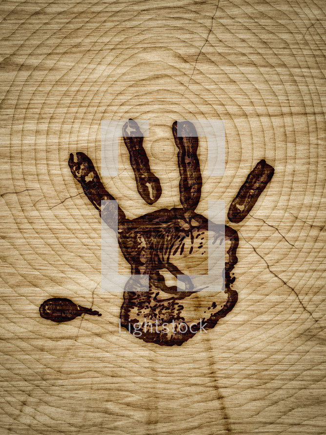 handprint branded into wood