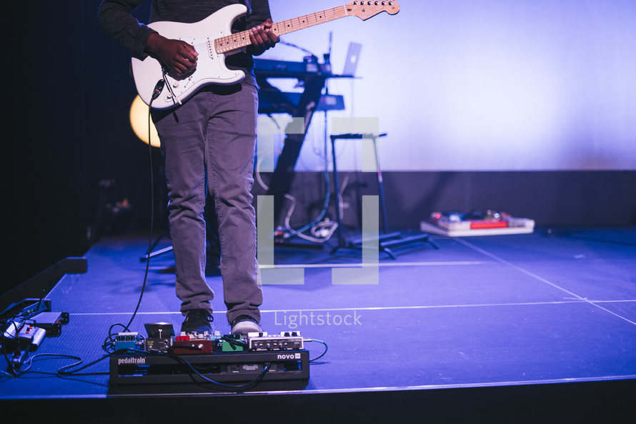 man with a guitar on stage