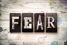word fear on wood background