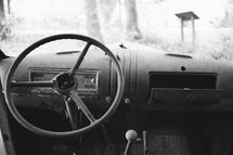 steering wheel in an old junk car