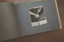 a torn photo of man and woman holding hands concept