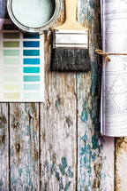 blueprints, paint brush, paint chips, pencil, fresh start, weathered, wood, background