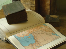 Old books and an old Bible with a map of Israel,.