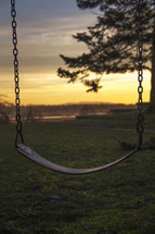 A swing at sunset