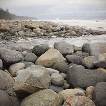 Rocks and boulders on the ocean's edge.