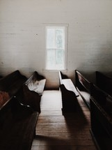 church pews and sunlight shining through a window