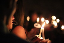 candles at a Christmas Eve worship Service