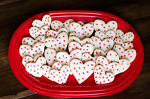 heart shaped cookies on a red platter