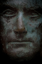 stoic face statue