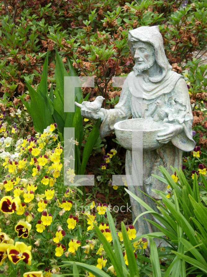 Saint Francis, the Patron Saint known to minister to the Animals. Here is a statue of Saint Francis with birds in a garden.