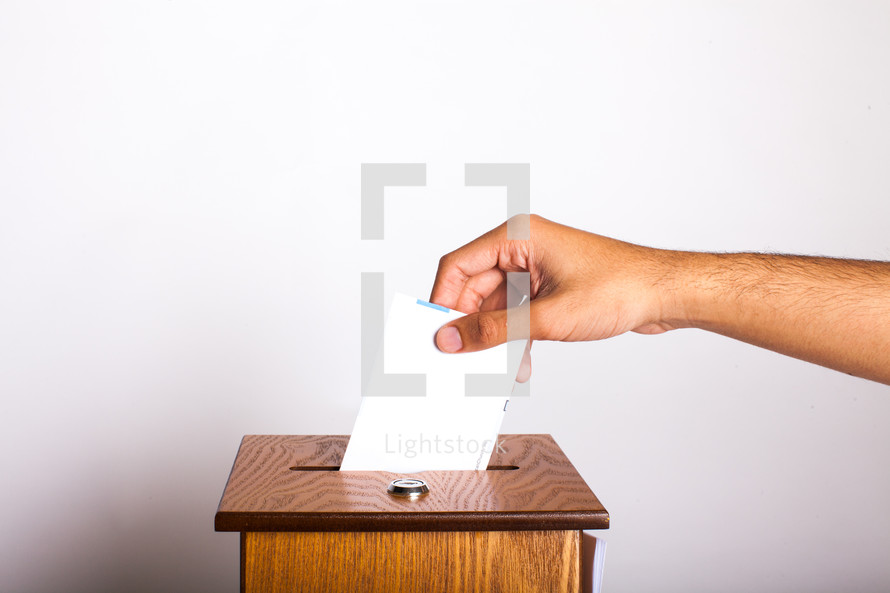 placing an envelope in the offering box