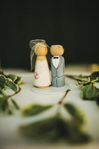 painted wood craft of bride and groom