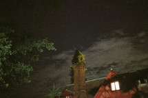 clouds over an inn at night