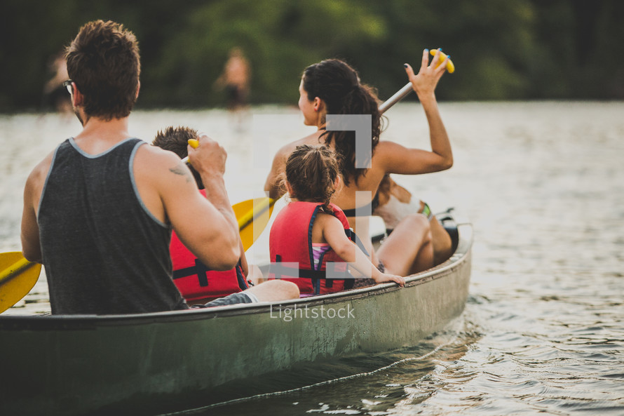 family rowing in a lake