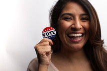 young woman and vote election day buttons