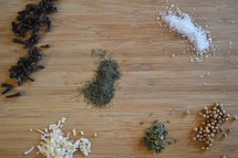 spices on a wood cutting board