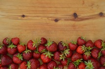 a border of fresh red strawberries