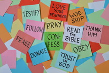 colorful pile of notepads with new year's resolutions for christian life