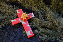 cross wrapped in paper as a present at Christmas day. 